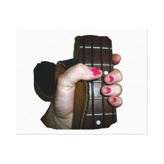 Female hand holding four string bass neck canvas print