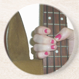 female hand holding four string bass neck drink coasters