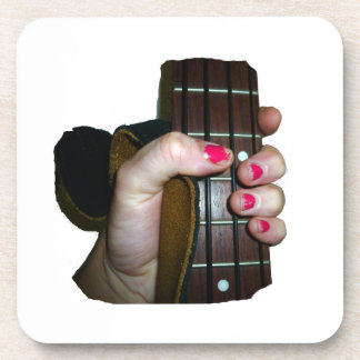 Female hand holding four string bass neck coaster