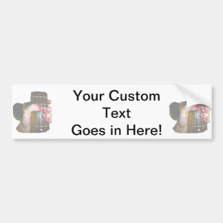 female hand holding four string bass neck faded bumper sticker