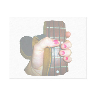 female hand holding four string bass neck faded canvas print
