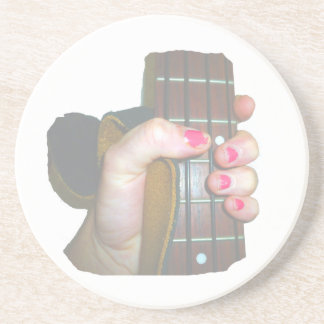 female hand holding four string bass neck faded coaster
