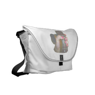 female hand holding four string bass neck faded messenger bag
