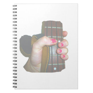 female hand holding four string bass neck faded notebook