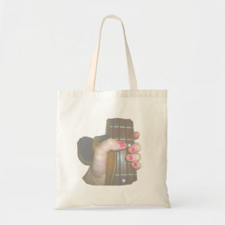 female hand holding four string bass neck faded tote bag