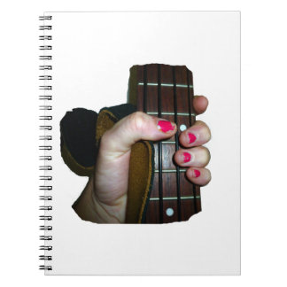 Female hand holding four string bass neck notebook