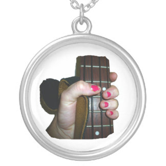 Female hand holding four string bass neck silver plated necklace