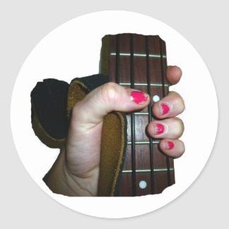 Female hand holding four string bass neck round stickers