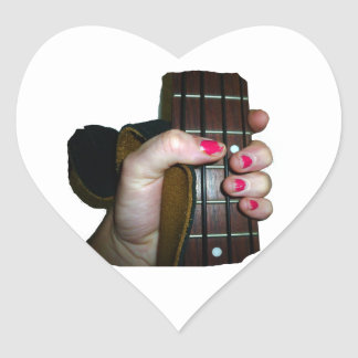 Female hand holding four string bass neck heart stickers