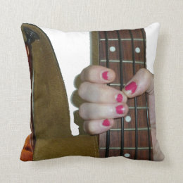 female hand holding four string bass neck throw pillow