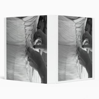 Female hand lacing up wedding dress back binder