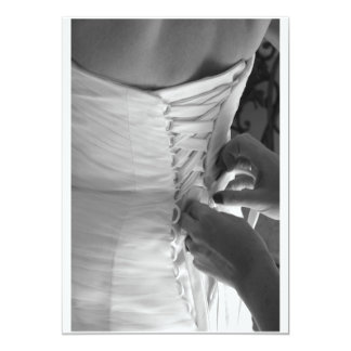 Female hand lacing up wedding dress back custom invites