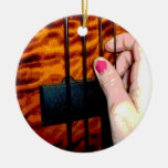 female hand pulling bass string 1 posterized ornaments