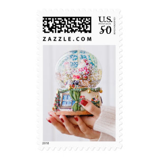 Female hands holding snowglobe/snowdome postage