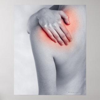 Female hands holding the shoulder and massaging print