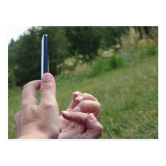 Female hands touching the screen of a smartphone postcard