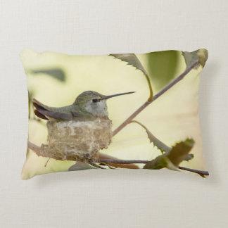 Female hummingbird on her nest accent pillow