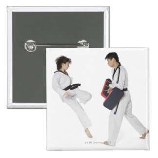 Female karate instructor teaching martial arts button