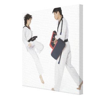 Female karate instructor teaching martial arts canvas print