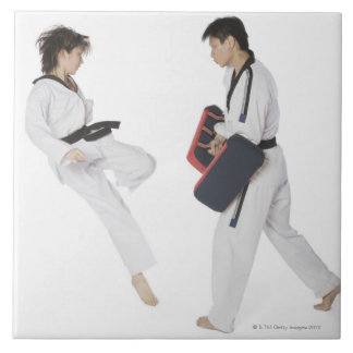 Female karate instructor teaching martial arts ceramic tile