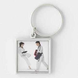 Female karate instructor teaching martial arts keychain