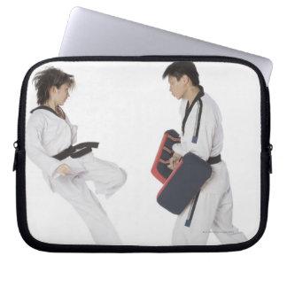 Female karate instructor teaching martial arts computer sleeve