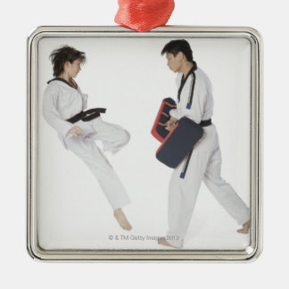 Female karate instructor teaching martial arts metal ornament