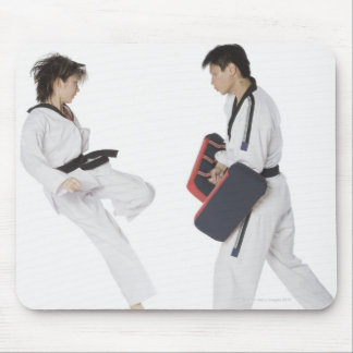 Female karate instructor teaching martial arts mouse pad