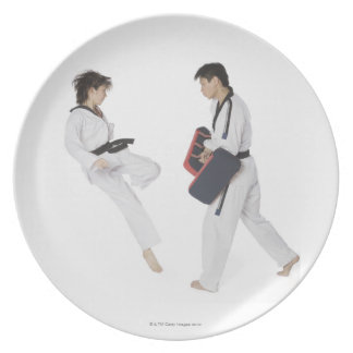 Female karate instructor teaching martial arts party plates