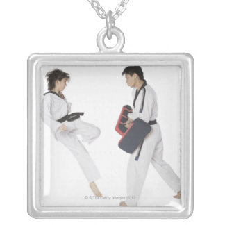 Female karate instructor teaching martial arts silver plated necklace