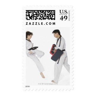Female karate instructor teaching martial arts stamp