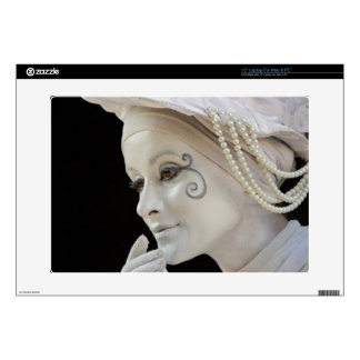 Female mime performing on street corner laptop skins