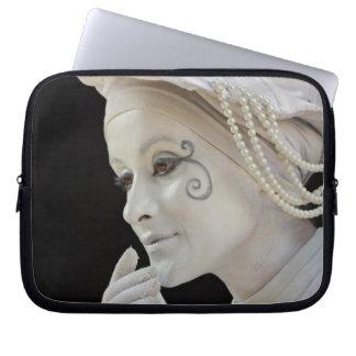 Female mime performing on street corner laptop sleeve