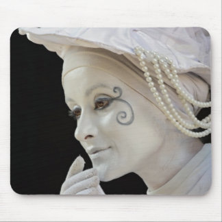 Female mime performing on street corner mouse pad