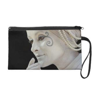 Female mime performing on street corner wristlet purse
