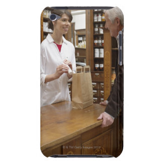 Female pharmacist advising customers iPod touch covers