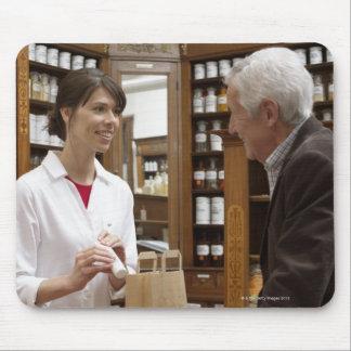 Female pharmacist advising customers mouse pad