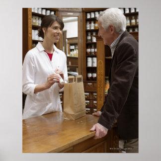 Female pharmacist advising customers poster
