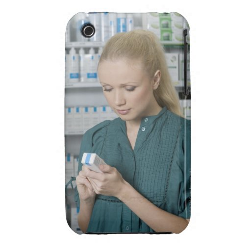 Female pharmacist looking at medicine in 2 iPhone 3 Case-Mate case
