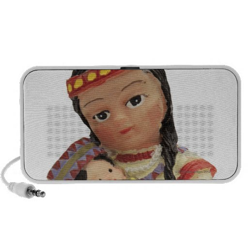 female red Indian doll holding a baby Mini Speaker