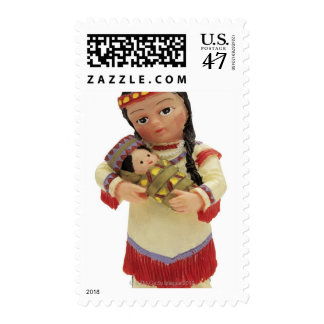 female red Indian doll holding a baby Postage