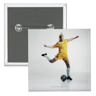 Female soccer player preparing to kick soccer 2 inch square button