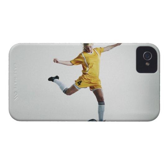 Female soccer player preparing to kick soccer iPhone 4 case