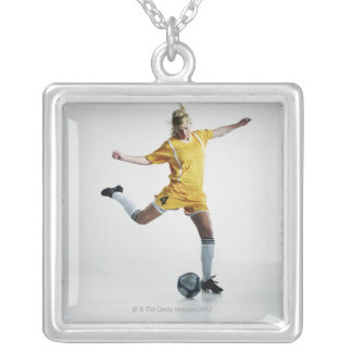 Female soccer player preparing to kick soccer silver plated necklace