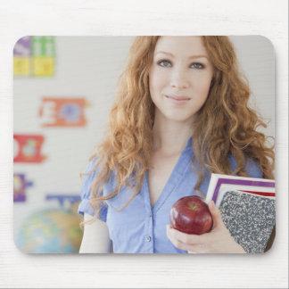 Female teacher at school mouse pad