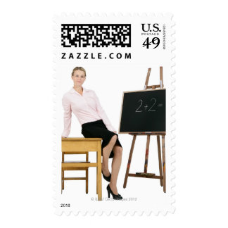 Female Teacher Posing by Wooden Desk Stamps