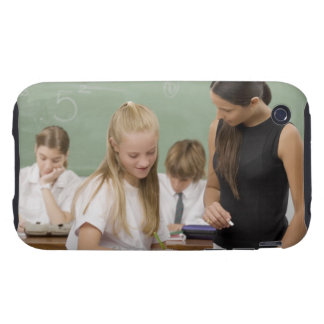 Female teacher teaching a schoolgirl with other iPhone 3 tough case