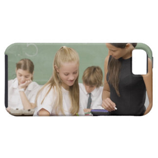Female teacher teaching a schoolgirl with other iPhone 5 covers