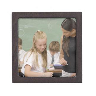 Female teacher teaching a schoolgirl with other premium keepsake box