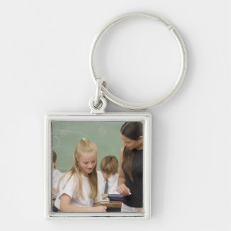 Female teacher teaching a schoolgirl with other Silver-Colored square keychain